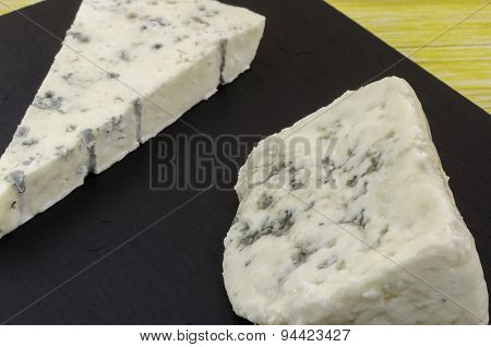 Roquefort And Gornozola Over Slate Plate.