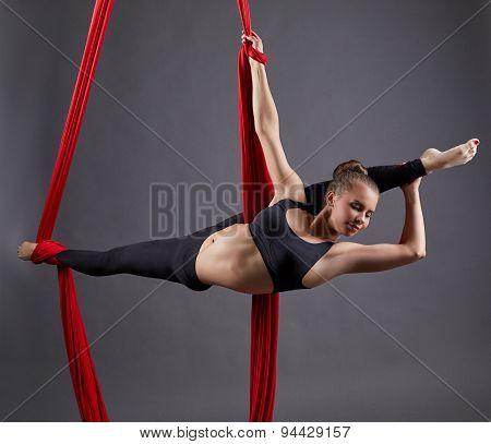 Aerial silk. Graceful girl dancing in studio