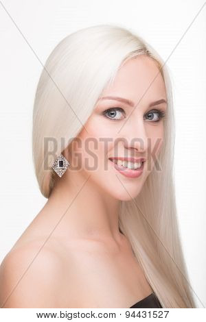 beautiful girl with long white hair and earrings. fashionable photo. portrait