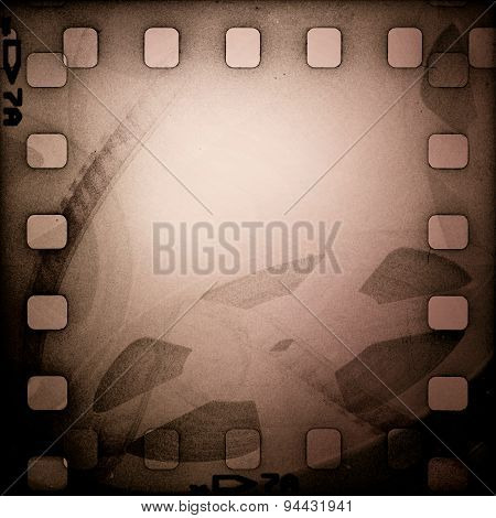 Grunge old motion picture reel with film strip. Vintage background
