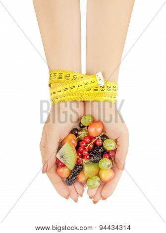 Healthy Eating, Dieting, Vegetarian Food And People Concept - Close Up Of Woman Hands Holding Berrie