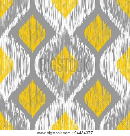 Seamless ikat pattern in yellow and grey colors. Tribal background