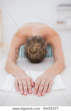 Patient relaxing on the floor in medical office