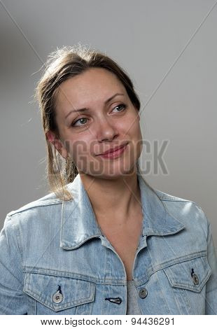 Portrait of a young woman in a denim jacket