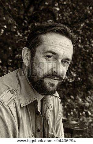 Black and white portrait of adult bearded man
