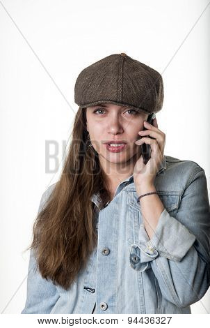 oung woman wearing a cap talking on the phone
