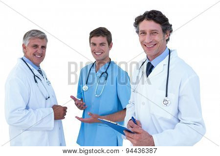Doctors and nurses discussing together on a white background