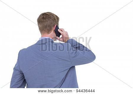Back turned businessman on the phone on a white background