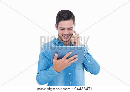 Handsome hipster on the phone holding tablet on white background