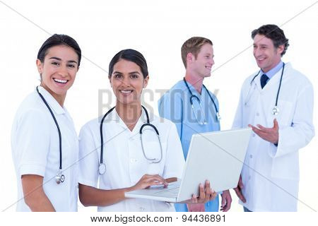 Doctors and nurses discussing and using laptotp on a white background