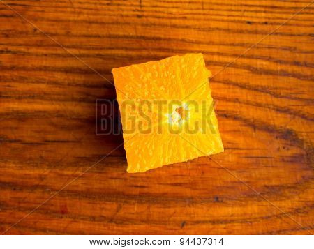 Square Orange fruit on a colored background.