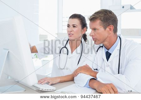 Concentrated doctors using computer in medical office
