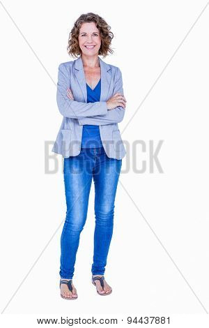 Businesswoman looking at camera with arms crossed on white background