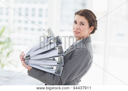 Businesswoman holding files in an office