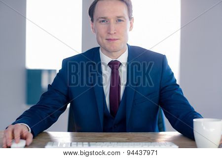 Confident businessman looking at camera in the office