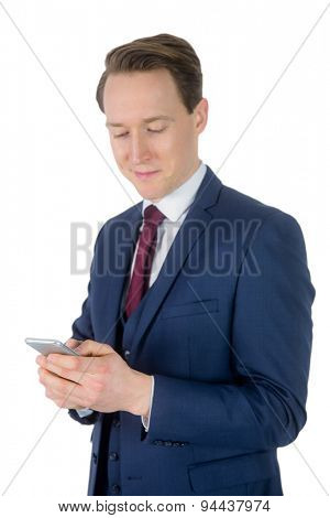 Businessman looking at his smartphone on white background