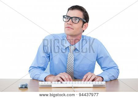 Concentrated businessman typing on the keyboard against a white screen
