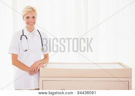 Portrait of a blonde doctor with stethoscope in the medical office