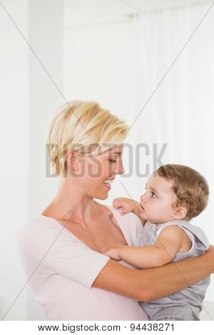 Smiling blonde woman with his son with white background