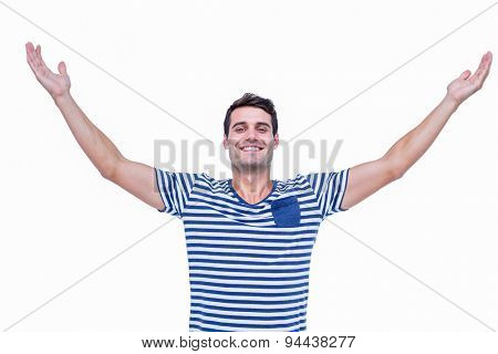 Handsome hipster smiling at camera with arms outstretched on white background
