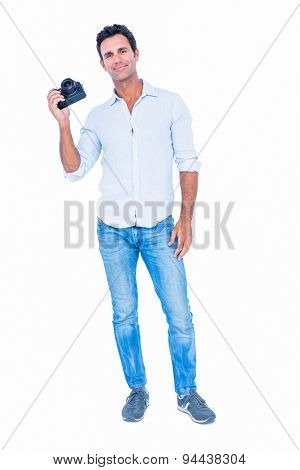 Handsome man holding photo camera on white background