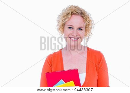 Happy pretty blonde holding notebook on white background