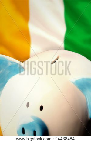 Piggy bank against ivory coast national flag