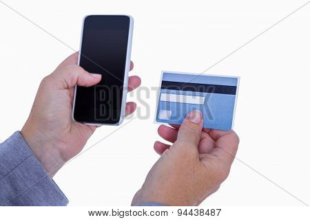 Woman holding credit card and smartphone on white background