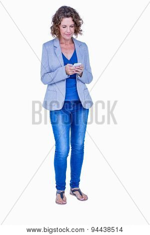 Businesswoman looking at her smartphone on white background