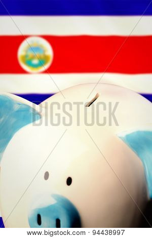 Piggy bank against costa rica national flag
