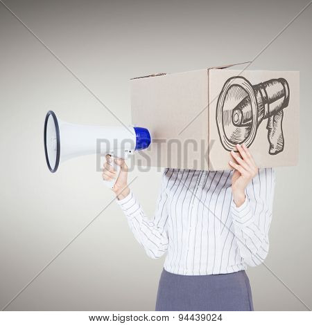 Businesswoman with box over head and holding a megaphone against grey vignette