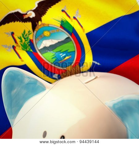 Piggy bank against digitally generated ecuador national flag
