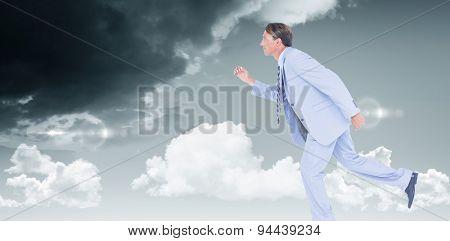 Stepping businessman against blue sky