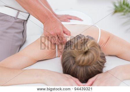 Physiotherapist doing shoulder massage in the medical office