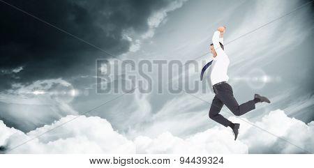 Jumping businessman against blue sky