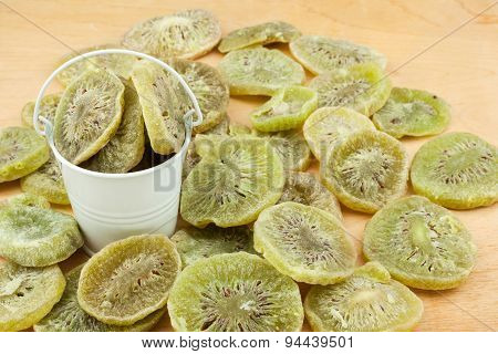 White Bucket With  Dried Kiwi On The Wooden Floor
