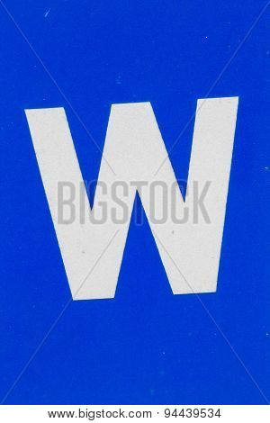 White Letter W From Traffic Road Sign