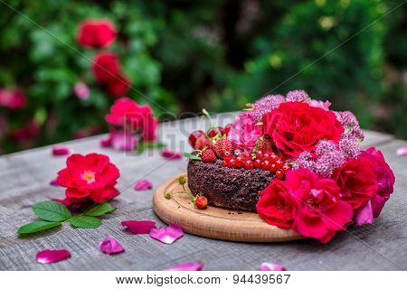 Cake Decorated By Berries And Roses