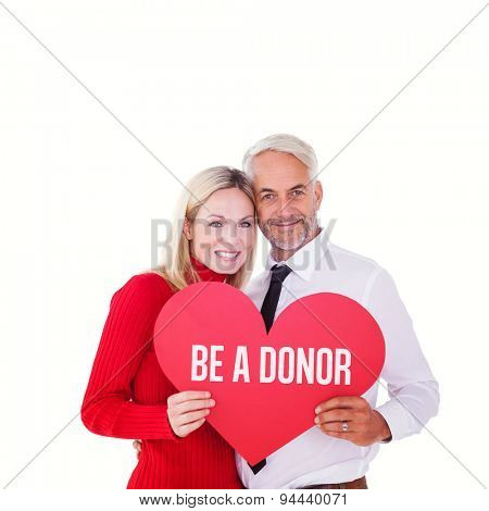 Handsome man getting a heart card form wife against be a donor