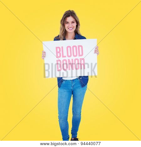 Woman holding poster against yellow vignette