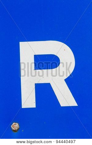 White Letter R From Traffic Road Sign