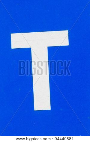 White Letter T From Traffic Road Sign