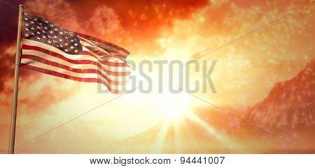 Lens flare against colourful fireworks exploding on black background