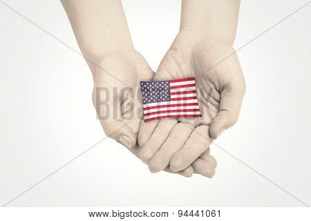 Hands presenting against usa national flag