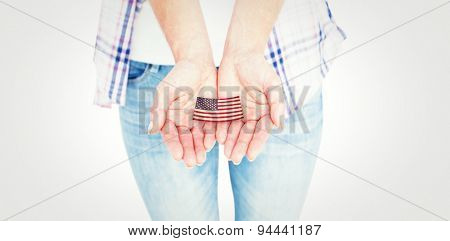 Hipster showing her hands against usa national flag