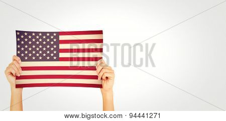 Hand showing card against usa national flag