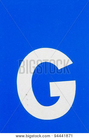 White Letter G From Traffic Road Sign