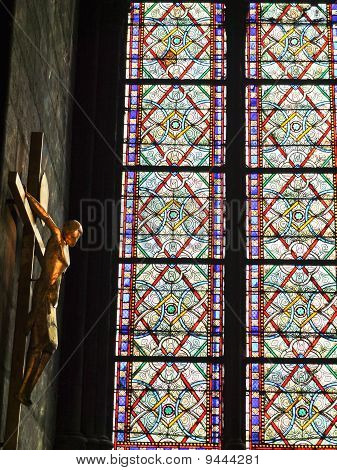 Stained Glass Window With Christ And  Cross