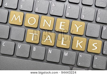 Golden money talks key on keyboard