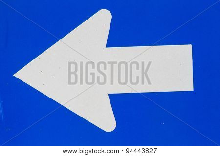 Blue Road Sign With White Arrow